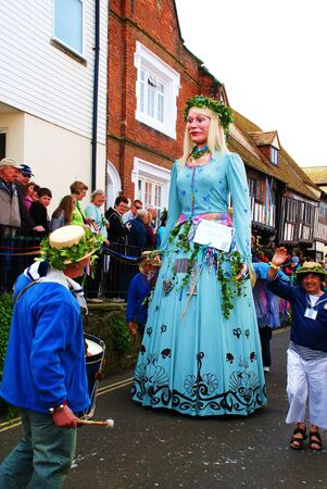 effigy: Hastings, England - May 5, 2009 - A large effigy of a woman (known as a Giant) is paraded through the Old Town during the annual Jack In The Green festival. Editorial