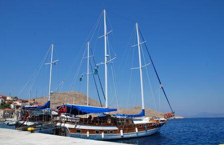 emborio: Halki, Greece - June 14, 2010 - A Turkish registered excursion boat moored at Emborio harbour on the Greek island of Halki.