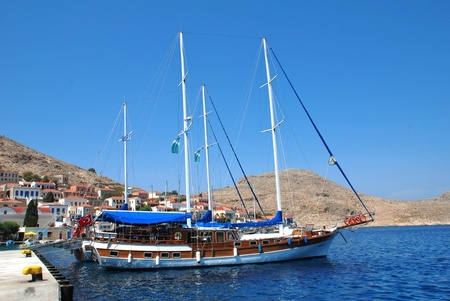 halki: Halki, Greece - June 14, 2010 - A Turkish registered excursion boat moored at Emborio harbour on the Greek island of Halki.