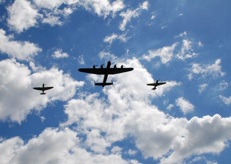 vickers: Tenterden, England - May 14, 2011 - The Battle of Britain Memorial Flight, consisting of a Lancaster bomber flanked by Spitfire and Hurricane fighters, give a display over Tenterden, Kent.