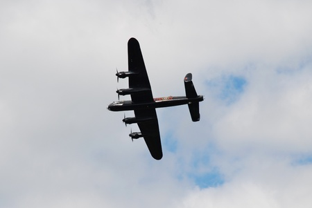 Tenterden, England - May 14, 2011 - An Avro Lancaster bomber plane, part of the Battle of Britain Memorial Flight,  gives a  display over Tenterden, Kent.