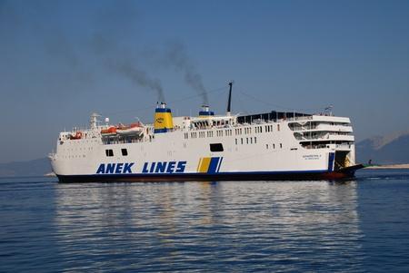 emborio: Halki, Greece - June 14, 2010 - ANEK Lines ship Iearapetra L. appoaches Emborio harbour on the Greek island of Halki. Founded in 1967 ANEK now operates a fleet of eleven ships.