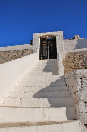 halki: Steep steps leading to the entrance of the Church of the Panagia (Virgin Mary) at Horio on the Greek island of Halki.