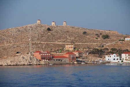 halki: Halki, Greece - June 16, 2010 - Looking towards Emborio on the Greek island of Halki. The Hiona Art Hotel is on the seafront.