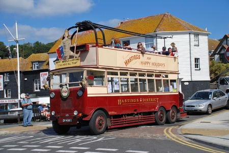 Hastings, England - July 30, 2011 - Happy Harold, a Guy BTX Trolley Bus dating from 1928, gives rides along the seafront during  the Old Town carnival. The electric bus was converted to diesel in 1959 and continued in service until 1968.  Stock Photo - 10738900