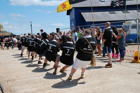 Hastings, England - July 30, 2011 - Local teams compete in a Tug of War match during the Old Town Carnival Week.