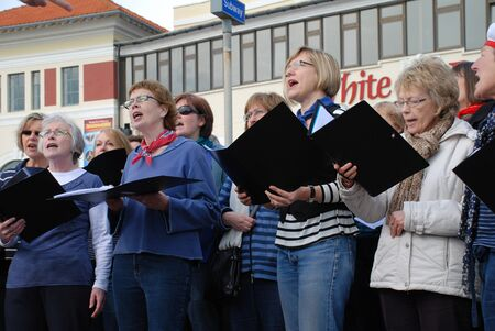 Hastings, England - March 12, 2011 - The Sound Waves Community Choir perform at a fund raising event on the seafront. The choir was formed in Hastings in 2009.