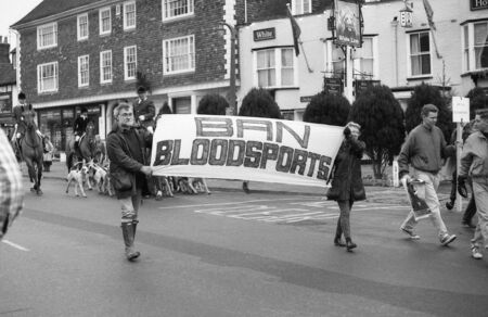 Tenterden, England - December 26, 1992 - Anti hunt protestors demonstrate in the High Street at the Boxing Day meet of the Ashford Valley Hunt. Fox hunting was outlawed in England and Wales in November 2004. Stock Photo - 11748909