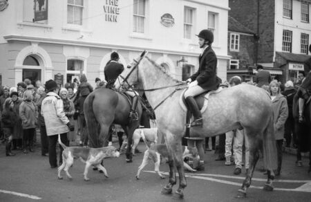 Tenterden, England - December 26, 1992 - The Ashford Valley Hunt assemble in the High Street prior to their Boxing Day meet. Fox hunting was outlawed in England and Wales in November 2004. Stock Photo - 11748914