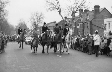 Tenterden, England - December 26, 1992 - The Ashford Valley Hunt rides past anti hunting protestors in the High street at their Boxing Day meet. Fox hunting was outlawed in England and Wales in November 2004. Stock Photo - 11748908