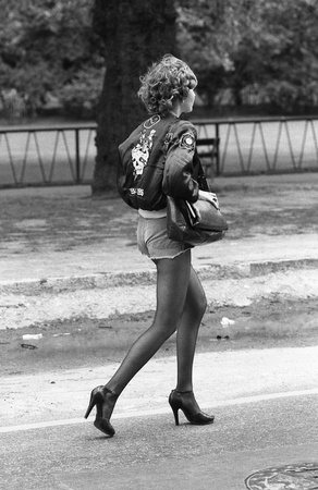 London, England - May 15, 1976 - A young woman in denim shorts takes  part in the Rock and Roll Radio Campaign march. The campaign called for more vintage Rock and Roll music to be played on British radio.