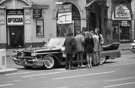 London, England - May 15, 1976 - Music fans admire a vintage American car during the Rock and Roll Radio Campaign march. The campaign called for more vintage Rock and Roll music to be played on British radio.