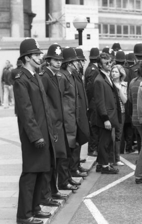London, England - May 15, 1976 - Police officers enforce crowd control during a march by music fans as part of the Rock and Roll Radio Campaign. The campaign called for more vintage Rock and Roll music to be played on British radio.