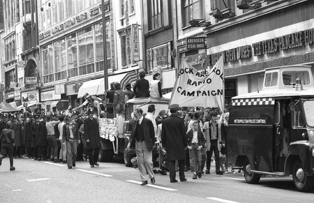 London, England - May 15, 1976 - Music fans march down Oxford Street as part of the Rock and Roll Radio Campaign. The campaign called for more vintage Rock and Roll music to be played on British radio.