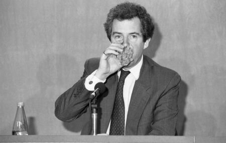 conservative: London, England - February 28, 1992 - Rt.Hon. William Waldegrave, Secretary of State for Health and Conservative party Member of Parliament for Bristol West, drinks water during a press conference. Editorial