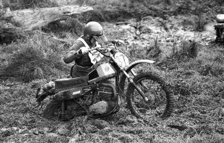 Sudbury, England - November 27, 1977 - Competitors bogged down in mud during the Sudbury Stages Enduro race.