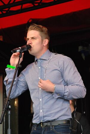 Tenterden, England - July 1, 2012 - Adam Chandler, British swingrock singer performs at the Tentertainment music festival. In 2007 his band Futureproff were finalists on reality music show The X Factor. Editorial