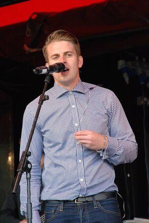 finalists: Tenterden, England - July 1, 2012 - Adam Chandler, British swingrock singer performs at the Tentertainment music festival. In 2007 his band Futureproff were finalists on reality music show The X Factor. Editorial