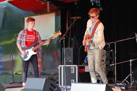 Tenterden, England - June 30, 2012 - Dom Purdie (left) and Ollie Bond f British blues band The Electric Church perform at the Tentertainment music festival.