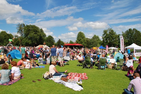 Tenterden, England - June 30, 2012 - The audience sitting on the grass at the Tentertainment music festival. The annual event was first held in 2008.