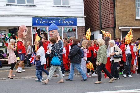 Rye, England - July 18, 2012 - People gather in the street prior to the Olympic Torch Relay.