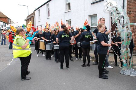 Rye, England - July 18, 2012 - The Blocco Drummers from Rye College play before the Olympic Torch Relay arrives.
