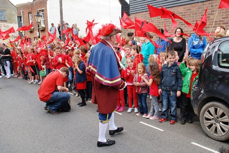 swain: Rye, England - July 18, 2012 - Rex Swain, Town Crier, talks to children waiting to see the Olympic Torch Relay.