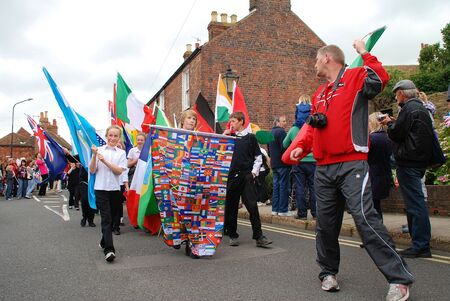 Rye, England - July 18, 2012 - Children parade through the streets at the Olympic Torch Relay event.