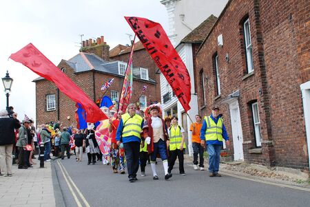 Rye, England - July 18, 2012 - People parade through the streets at the Olympic Torch Relay event.