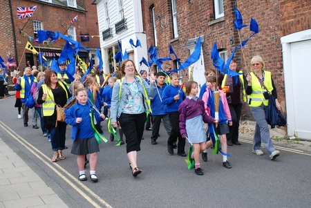 Rye, England - July 18, 2012 - People parade through the streets during the Olympic Torch Relay event.