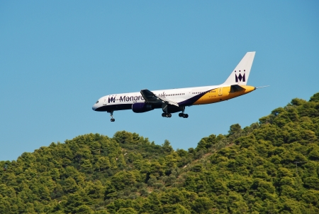 civilian: Skiathos, Greece - September 21, 2012 - Monarch Airlines Boeing 757, G-DAJB, prepares to land at Skiathos airport. G- DAJB first entered service in 1987. Editorial