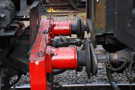buffers: Tenterden, England - August 20, 2012 - Close up of the buffers and couplings of USA 0-6-0T class steam locomotive at Tenterden station on the Kent and East Sussex Railway. The engine was built in the United States in 1943.