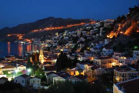 Night time view of Yialos on the Greek island of Symi  photo