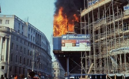 riots: London, England - March 31, 1990 - The South African embassy on fire during the Poll Tax Riots in Trafalgar Square. The protests were against the Community Charge introduced by the Conservative government.