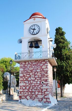 The clocktower at the Church of St Nicholas in Skiathos Town on the Greek island of Skiathos  photo