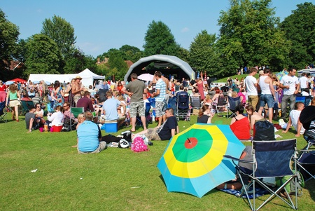 Tenterden, England - July 3, 2011 - The audience sitting on the grass at the Tentertainment music festival. The annual free event was first held in 2008.