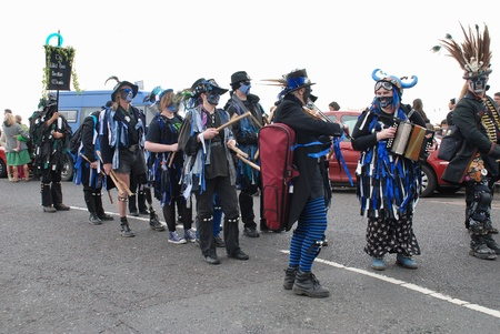 bedlam: Hastings, England - May 7, 2012 - The Wild Hunt Bedlam Morris dancers parade on the West Hill at the annual, May Day, Jack In The Green festival.