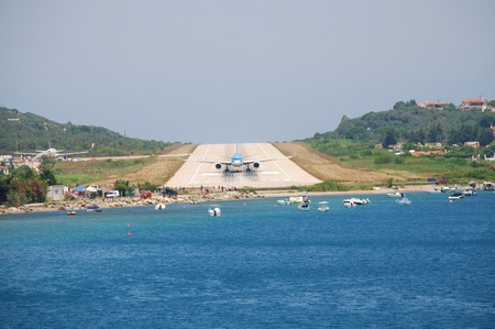 Skiathos, Greece - June 14, 2013 - An airliner on the runway at Alexandros Papadiamantis airport on the Greek island of Skiathos. At 5441 foot, the runway is amongst the shortest in Europe.