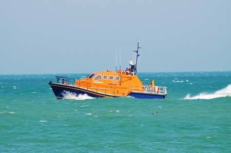 Eastbourne, England - August 11, 2012 - The Eastbourne lifeboat Diamond Jubilee on patrol during the Airbourne airshow. The Tamar class all weather lifeboat entered service in Eastbourne in June 2012.