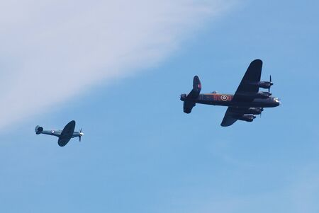 Eastbourne, England - August 11, 2012 - Avro Lancaster bomber PA474 and Spitfire fighter PS515 of the Battle of Britain Memorial Flight perform at the Airbourne airshow. Built in 1945, PA474 is one of only two airworthy Lancasters remaining.