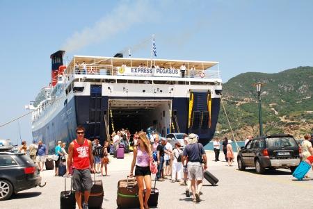 mamma: Skopelos, Greece - June 24, 2013 - Hellenic Seaways ferry Express Pegasus disembarks passengers at Skopelos Town harbour on the Greek island of Skopelos  The island was the main location of the 2008 film Mamma Mia  Editorial
