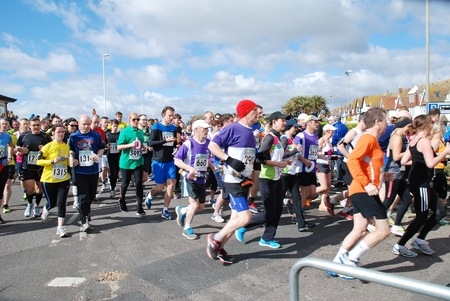 hastings: Hastings, England - March 23, 2014 - Runners take part in the 30th annual Hastings Half Marathon race  Editorial