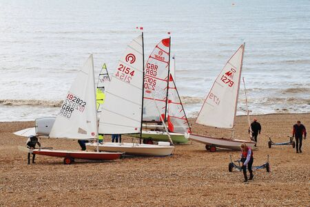 dinghies: St Leonards-on-Sea, England - March 23, 2014 - Sailing dinghies of the Hastings and St Leonards Sailing Club on the shingle beach  The present day club was founded in 1953  Editorial