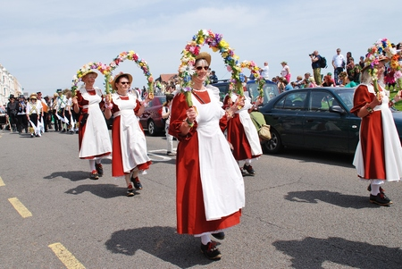 morris: Hastings, England - May 5, 2014 - Members of the Copperfield Clog Morris team perform during a parade on the West Hill at the annual Jack In The Green festival  The event is held on the May Day public holiday in Britain  Editorial