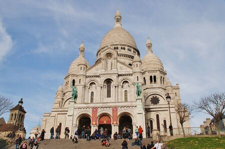 Paris, France - March 19, 2014 - The Roman Catholic Basilica of Sacre Coeur in Montmartre  Designed by Paul Abadie, construction began in 1875 and was completed in 1914