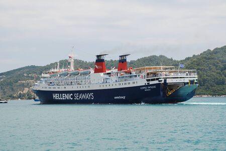 skiathos: Skiathos, Greece - June 14, 2013 - Hellenic Seaways ferry Express Pegasus prepares to dock at Skiathos Town harbour on the Greek island of Skiathos  The 125 7mtr ship was built in 1977 in Italy  Editorial