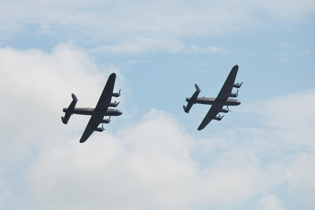 Eastbourne, England - August 14, 2014 - The last two flying Avro Lancaster bombers perform together at the Airbourne airshow  PA474  front  of the Battle of Britain Memorial Flight was joined by KB726 of the Canadian Warplane Heritage Museum