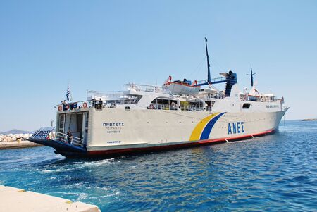 reversing: Alonissos, Greece - June 23, 2013 - Anes Lines ferry Proteus docking at Patitiri harbour on the Greek island of Alonissos. The 87.91mtr ship was built in Greece in 1973.