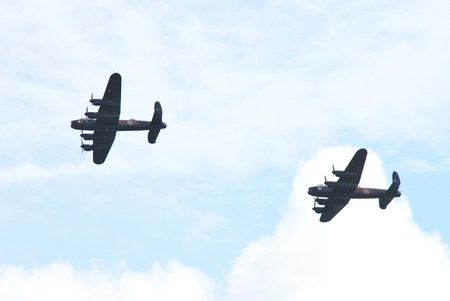 Eastbourne, England - August 14, 2014 - Lancaster bomber PA474 (front) of the Battle of Britain Memorial Flight with Lancaster KB726 of the Canadian Warplane Heritage Museum display at the Airbourne airshow.