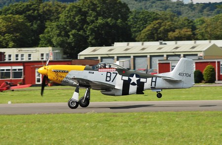 Dunsfold, England - August 23, 2014 - Mustang P-51D, Ferocious Frankie, taking off during the Dunsfold airshow. The aircraft was built in 1944 before serving in the US Air Force.